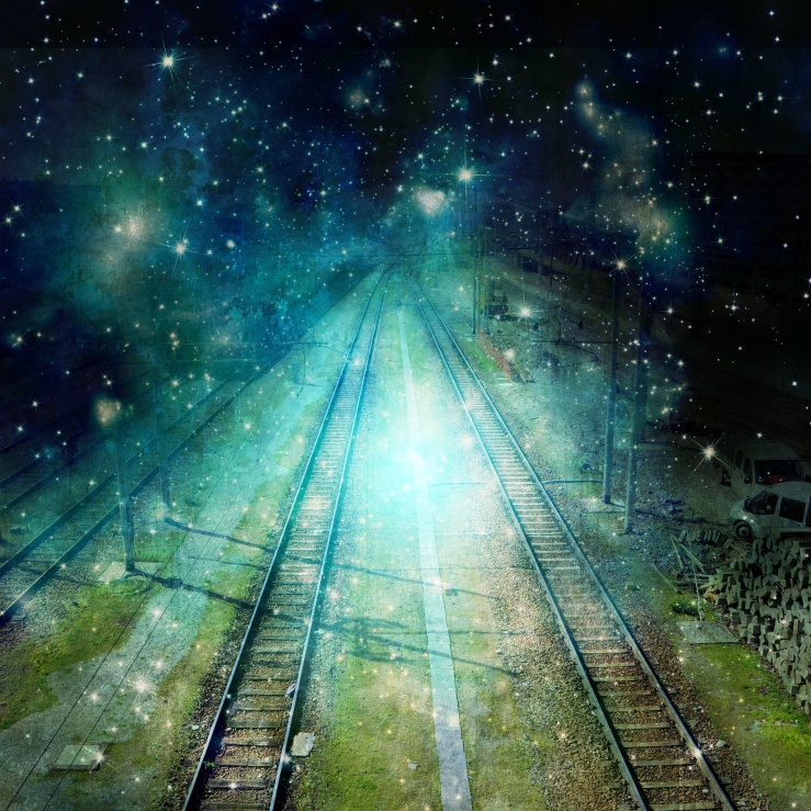 Surreal train tracks go towards the night with star light effect.